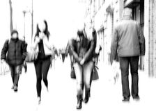 People on the sidewalk, blurred. Blurred people (men and women) in the city Royalty Free Stock Photos