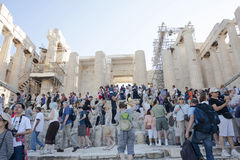 People sightseeing Athena Nike Temple. ATHENS, GREECE - OCTOBER 6 : Tourists  sightseeing the ruins of the Temple of Athena Nike in the Acropolis of Athens, on Royalty Free Stock Images