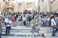 People sightseeing Athena Nike Temple in Greece. ATHENS, GREECE - OCTOBER 6 : Tourists sightseeing the ruins of the Temple of Athena Nike in the Acropolis of Royalty Free Stock Photo