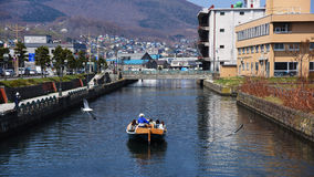 people sightseeing Otaru canal by boat Royalty Free Stock Image