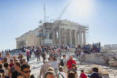 People sightseeing Parthenon. ATHENS, GREECE - OCTOBER 6 : Tourists sightseeing the Parthenon, the temple in the Acropolis of Athens on October 6th, 2011 in Royalty Free Stock Photography