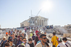 People sightseeing Parthenon in Greece. ATHENS, GREECE - OCTOBER 6 : Tourists sightseeing the Parthenon, the temple in the Acropolis of Athens on October 6th Royalty Free Stock Photography