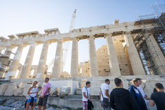 People sightseeing Parthenon temple in Greece. ATHENS, GREECE - OCTOBER 6 : Tourists sightseeing the Parthenon, the temple in the Acropolis of Athens on October Royalty Free Stock Photos