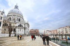 People sightseeing Santa Maria della Salute in Venice Royalty Free Stock Photo