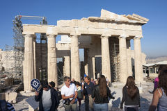 People sightseeing Temple of Athena Nike in Athens. ATHENS, GREECE - OCTOBER 6 : Tourists sightseeing the ruins of the Temple of Athena Nike in the Acropolis of Stock Photography