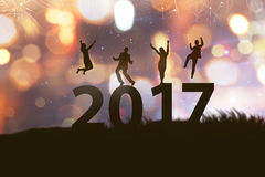 People silhouette celebrate 2017 new year. With fireworks background Stock Photography
