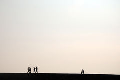People in silhouette on Cobb Royalty Free Stock Image