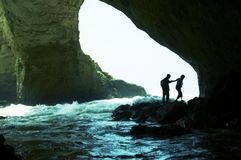 People silhouette in grotto royalty free stock photos