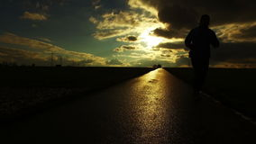 People Silhouette on Road in Field Nature in Sunset Landscape. Video stock video footage