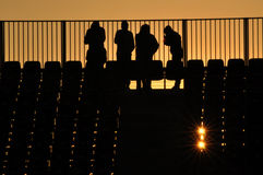 People silhouette at a stadium in the sunset Royalty Free Stock Images