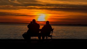People silhouette on the sunset light near the lake Balaton in Hungary.  Stock Photo