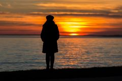 People silhouette on the sunset light near the lake Balaton in Hungary.  Royalty Free Stock Photos