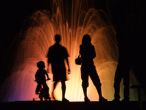 People silhouettes. Dreamy people silhouettes at night Royalty Free Stock Photography