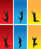 People silhouettes. Black silhouettes of people jumping and dancing on red blue and yellow backgrounds Royalty Free Stock Photos