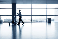 People silhouettes at airport Stock Photos