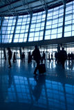People silhouettes at airport Royalty Free Stock Image