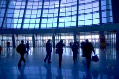 People silhouettes at airport Stock Images