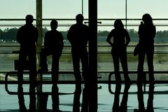 People silhouettes at airport. Building royalty free stock images