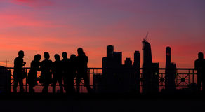 People silhouettes city Moscow. Silhouettes of young people watching the Moscow cityscape from the observation deck by a summer evening with a blue and red sky Stock Photos