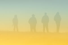 People silhouettes in fog Royalty Free Stock Photos