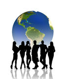 People silhouettes in front of the globe Stock Photo