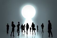 People silhouettes and keyhole Royalty Free Stock Photo