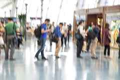 People silhouettes in motion blur, airport interior Royalty Free Stock Image