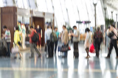People silhouettes in motion blur, airport interior Stock Images