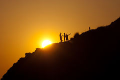People silhouettes on a mountainside Stock Photo