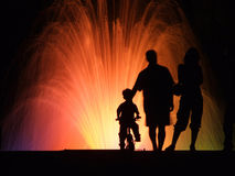 People silhouettes night. Silhouettes of people at night watching colorful fountain night show Stock Image