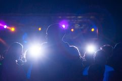 people silhouettes in nightclub with lights royalty free stock photos