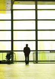 People silhouettes at office building Stock Photos
