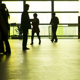 People silhouettes at office building Royalty Free Stock Image