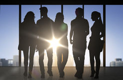 People silhouettes over office background Stock Image