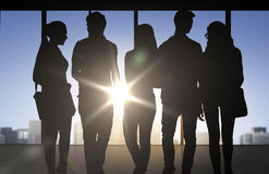 People silhouettes over office background Stock Photography