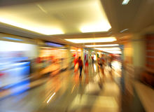 People silhouettes at shopping mall. In motion blur Stock Photos