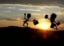 People silhouettes at sunset. People silhouettes dancing in sunset Stock Images
