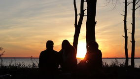 People silhouettes at sunset a clear summer night stock video footage