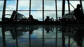 People silhouettes walking at airport Royalty Free Stock Image