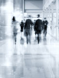People silhouettes walking Stock Images
