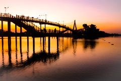 People silhouettes watching colorful sunset bridge sunset river bridge people silhouette admire wallpaper Silhouettes of people stock images