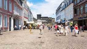 People on Simeonstrasse and view of Porta Nigra. TRIER, GERMANY - JUNE 28, 2010: people on Simeonstrasse street and view of ancient roman monument Porta Nigra Stock Photo