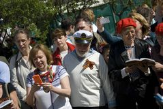 People sing war songs on the Theater Square in Moscow. Stock Image