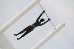 People @ Singapore. Black people hanging statue at Singapore Stock Photos