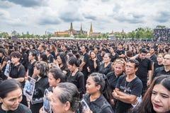 People singing the anthem of Thai king Royalty Free Stock Image