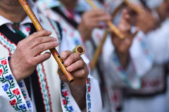 People singing at traditional wooden flutes Stock Images