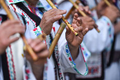People singing at traditional wooden flutes Stock Photo