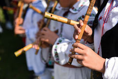 People singing at traditional wooden flutes Royalty Free Stock Photography