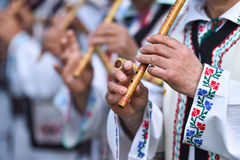 People singing at traditional wooden flutes Royalty Free Stock Image