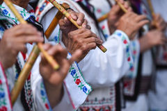 People singing at traditional wooden flutes Royalty Free Stock Images